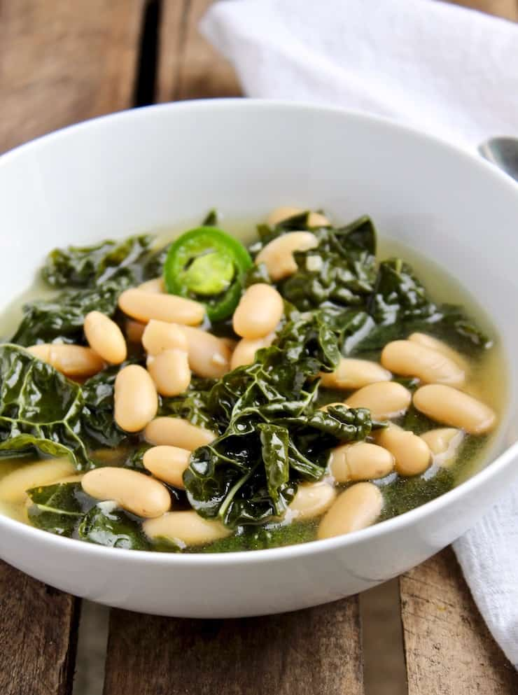Tuscan Kale and Cannellini Bean Soup in white bowl