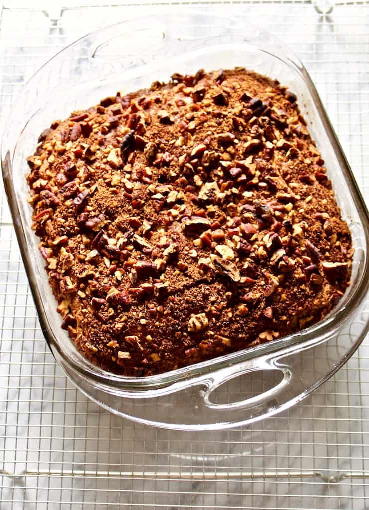 Baked coffee cake cooling in pan on rack.