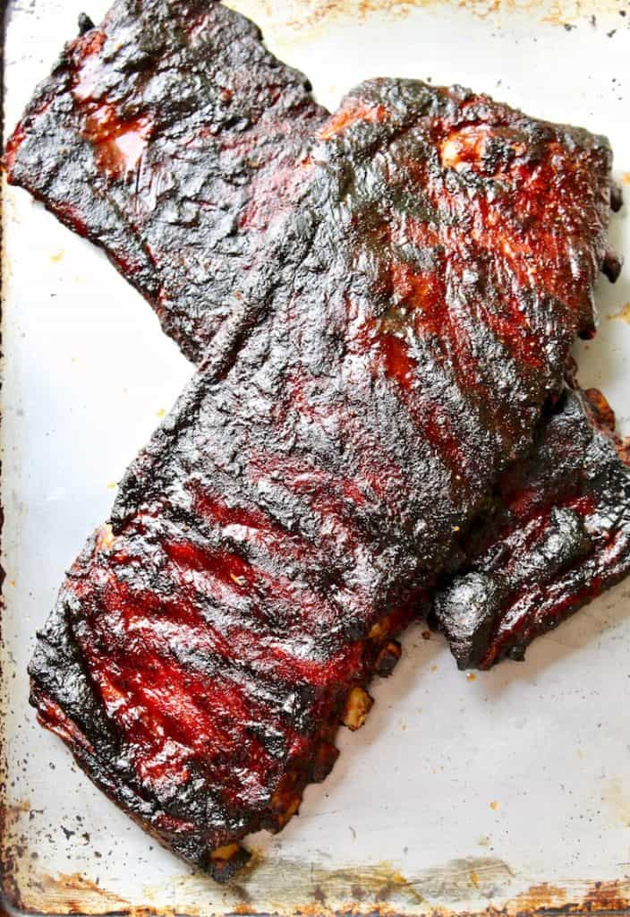 Two slabs of cooked St. Louis style ribs.