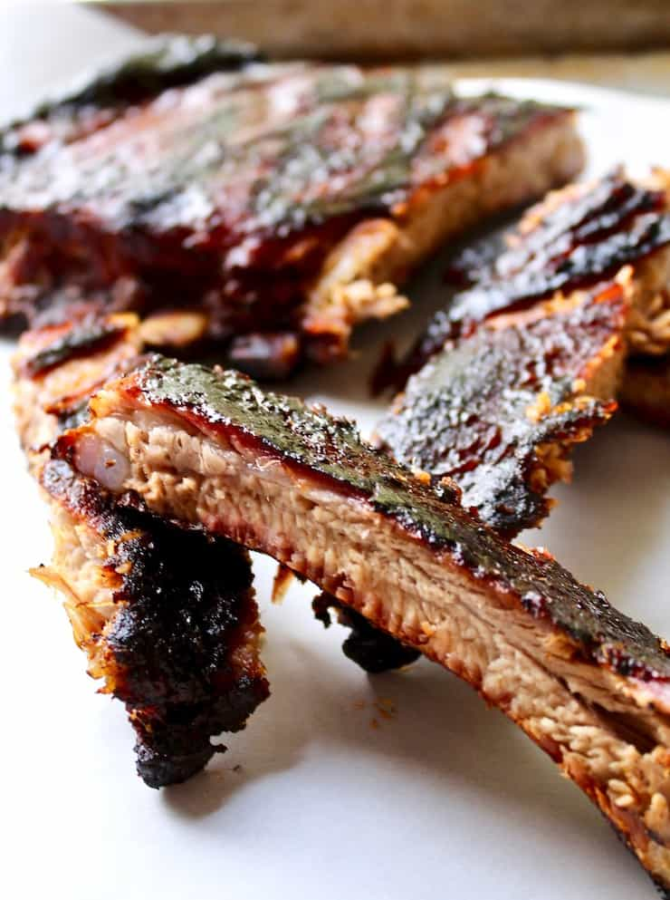 St. Louis style BBQ ribs, close up of single rib section.