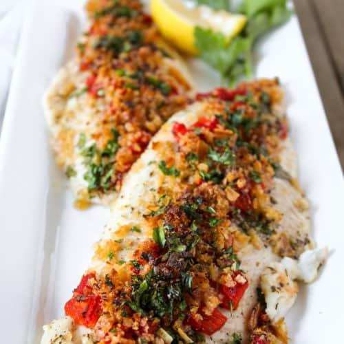 Greek baked fish on serving platter.