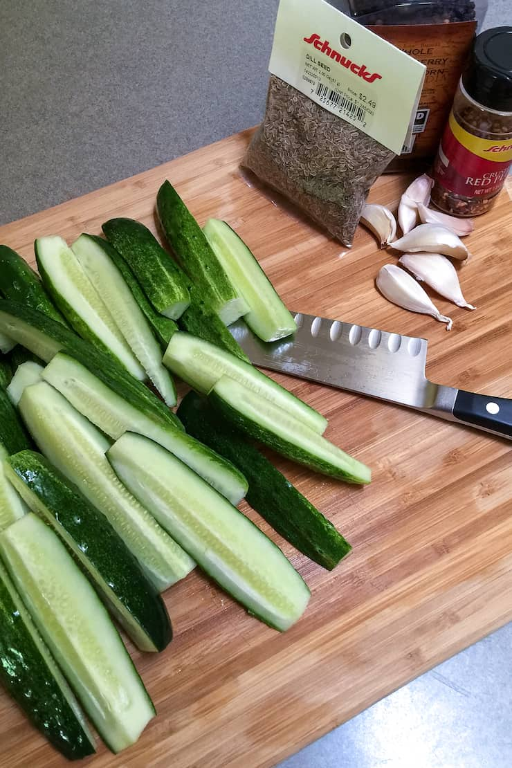 Cutting cucumbers into spears.