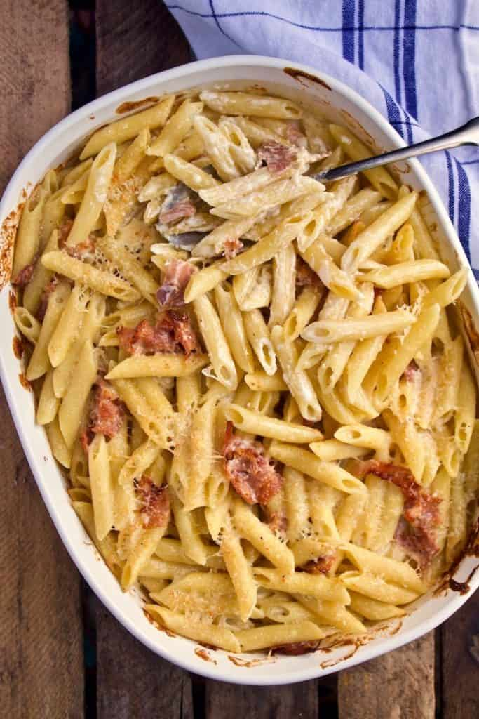 Penne with Prosciutto and Cream, in baking dish with serving spoon