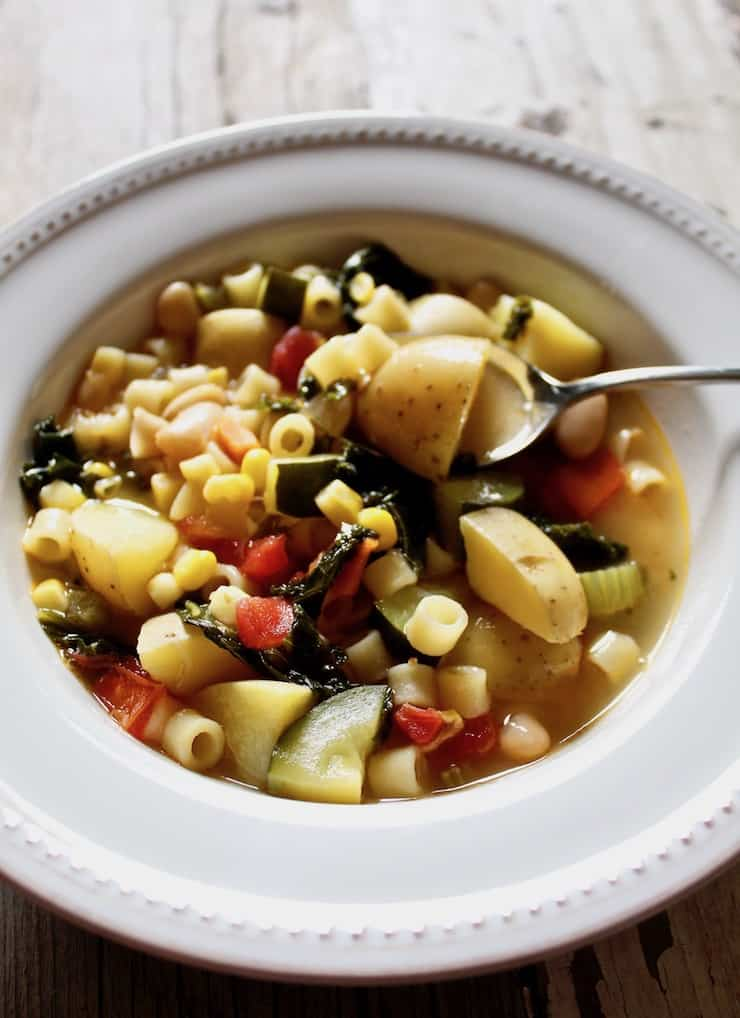 Summer minestrone in bowl with spoon