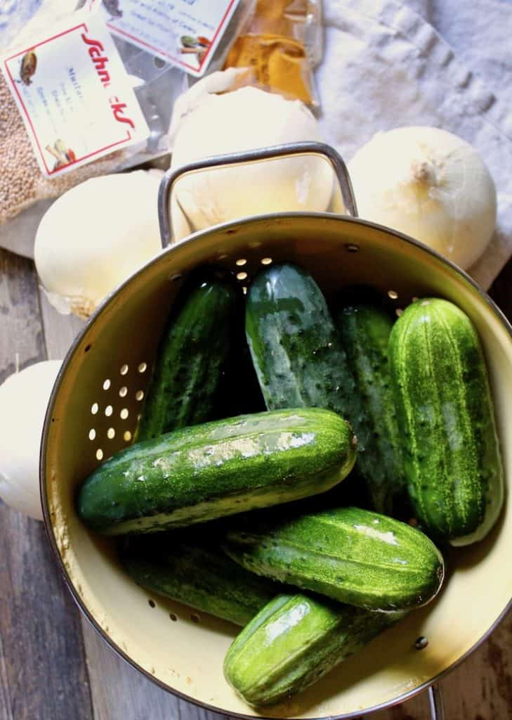 Bread and Butter Pickles, pickling cucumbers in colander with other ingredients