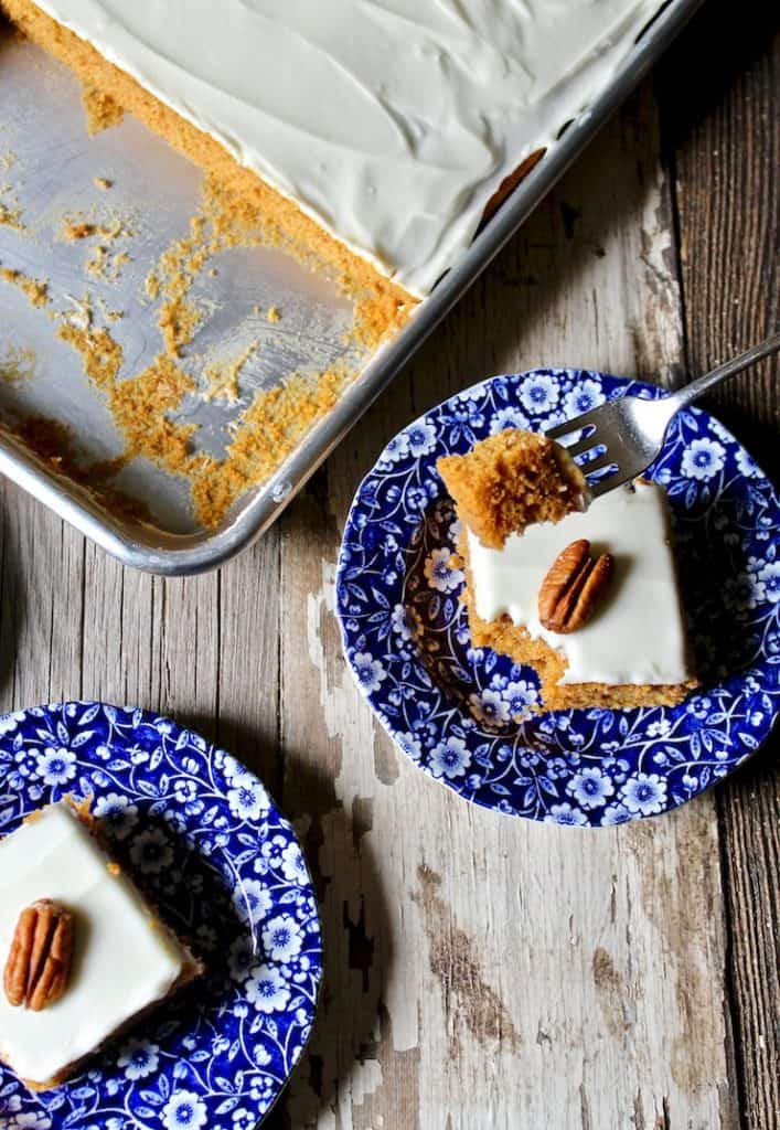 Pumkin bars on serving pans with sheet pan in background.