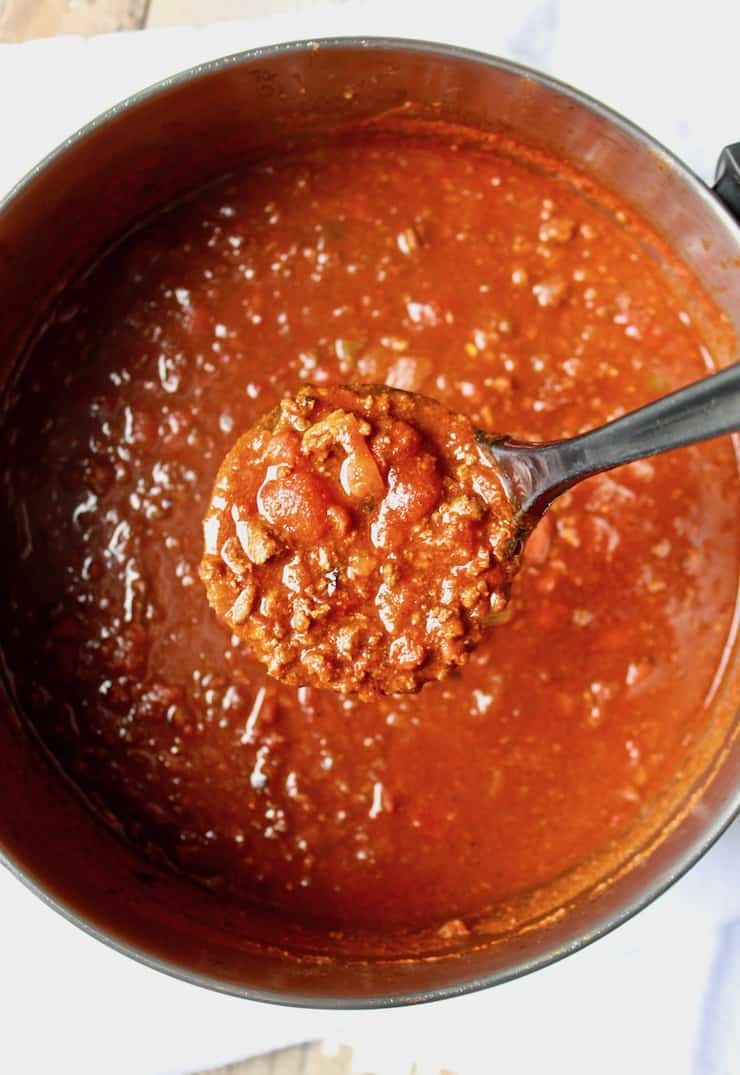 Chili Mac, overhead in pot with ladle full of chili.