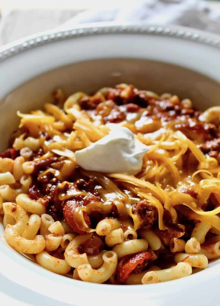 Chili Mac, close up in bowl with toppings.