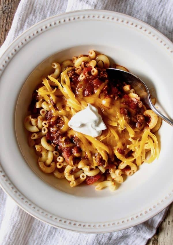 Chili Mac, in serving bpowl with grated cheese and sour cream.