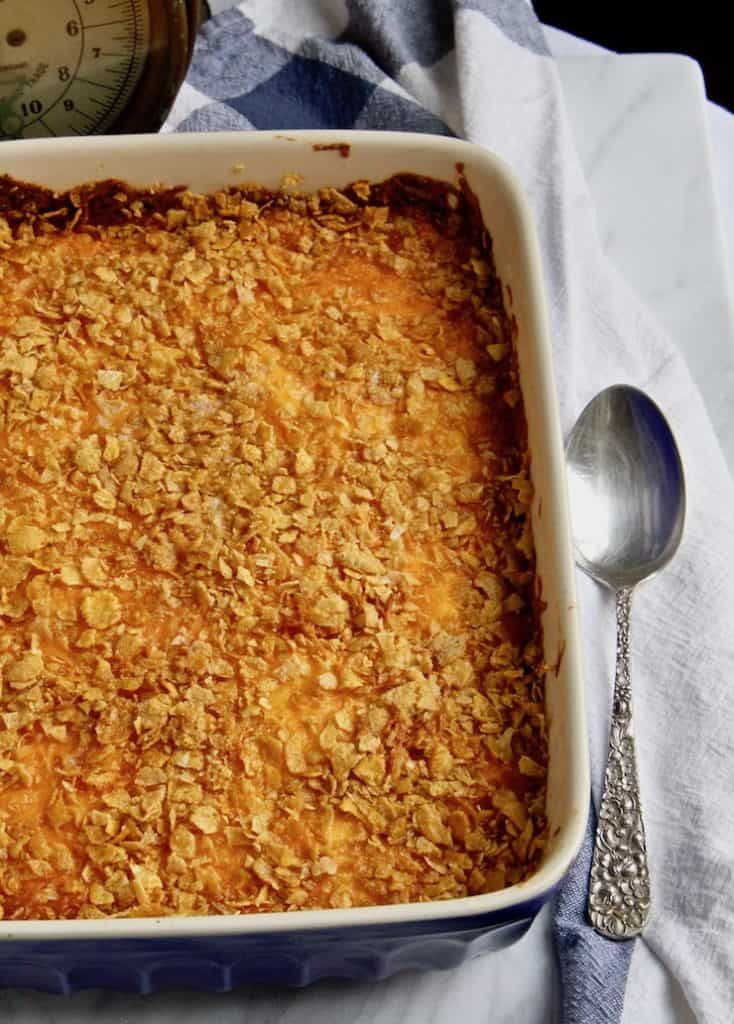 Cheesy Potatoes, in baking dish with browned cornflake topping.