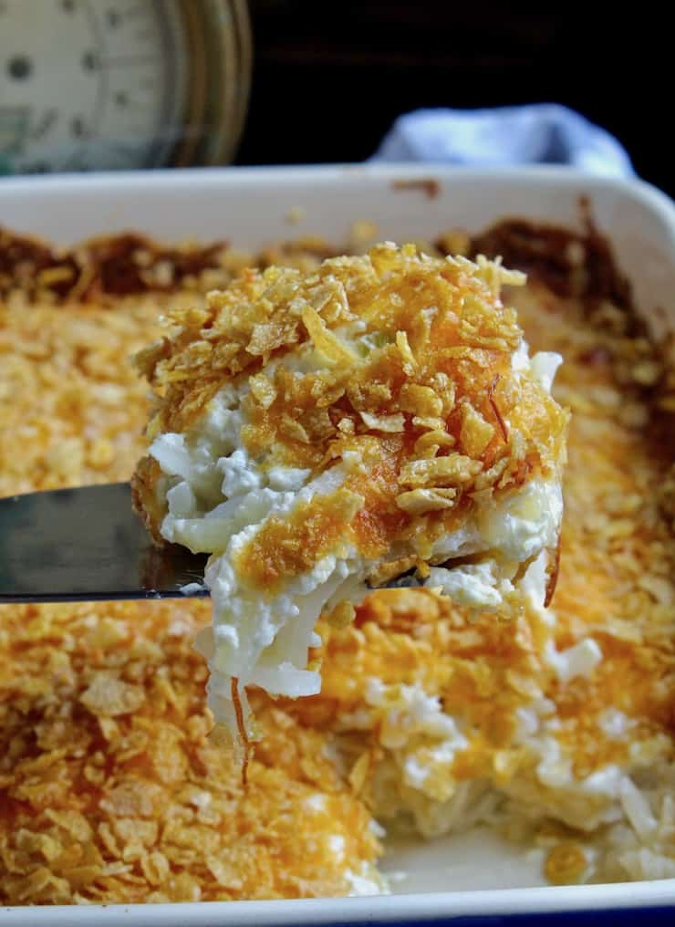 Cheesy Potatoes, close up serving on spatula