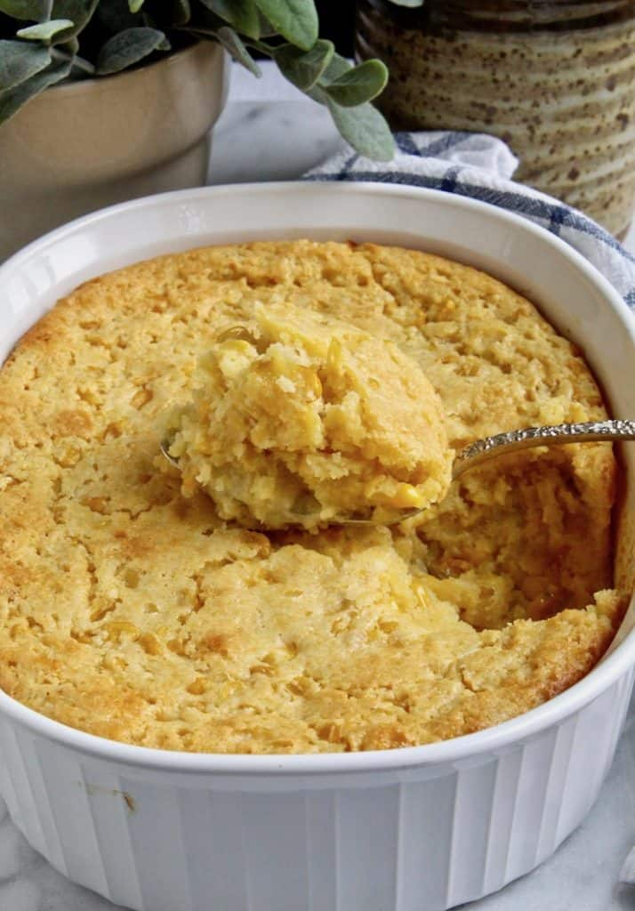 Corn Soufflé, in serving dish with large spoonful.