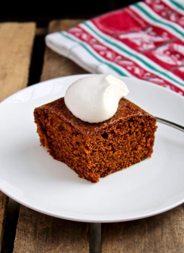 Gingerbread, on serving plate with whipped cream
