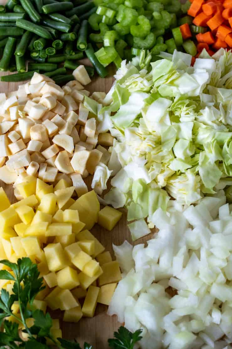 Cutting board filled with prepped and chopped vegetables.