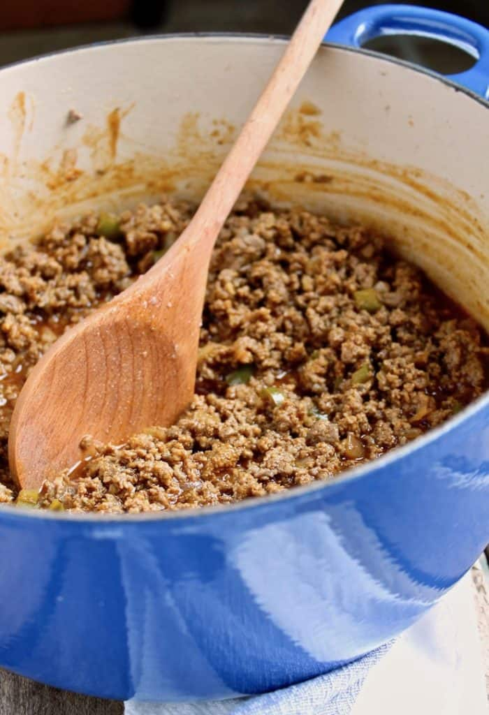 Sloppy Joes, close up in pot with wooden spoon.