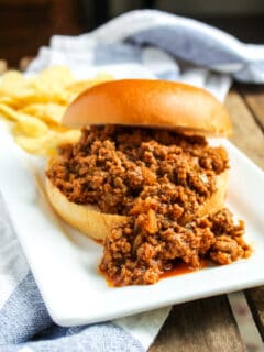 Sloppy Joe and chips on plate.