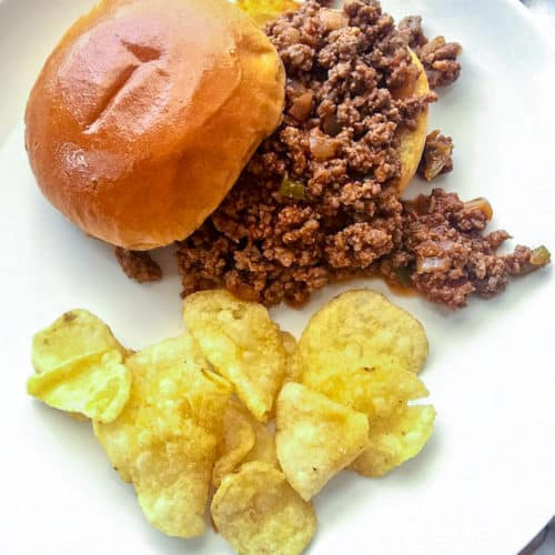 Sloppy Joes, sandwich on plate with chips.