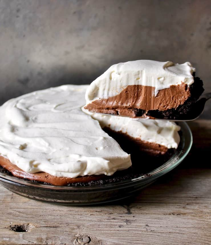 Chocolate Cream Pie slice held above pie plate
