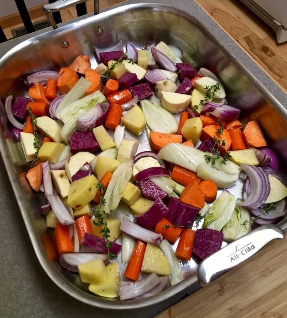 Root vegetables in roasting pan.