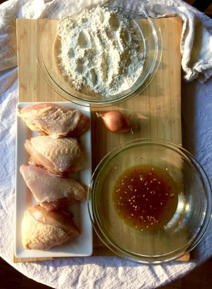 Ingredients for orange glazed chicken on cutting biard.
