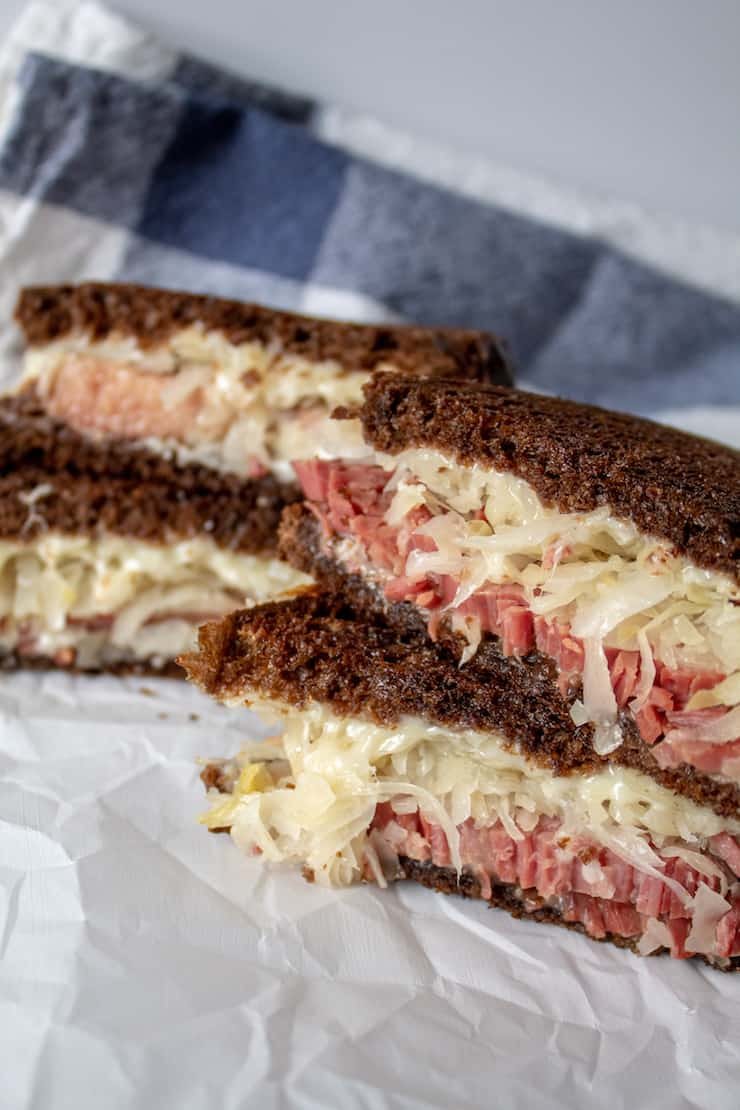 Reubens, two sandwiches, cut in half and stacked.