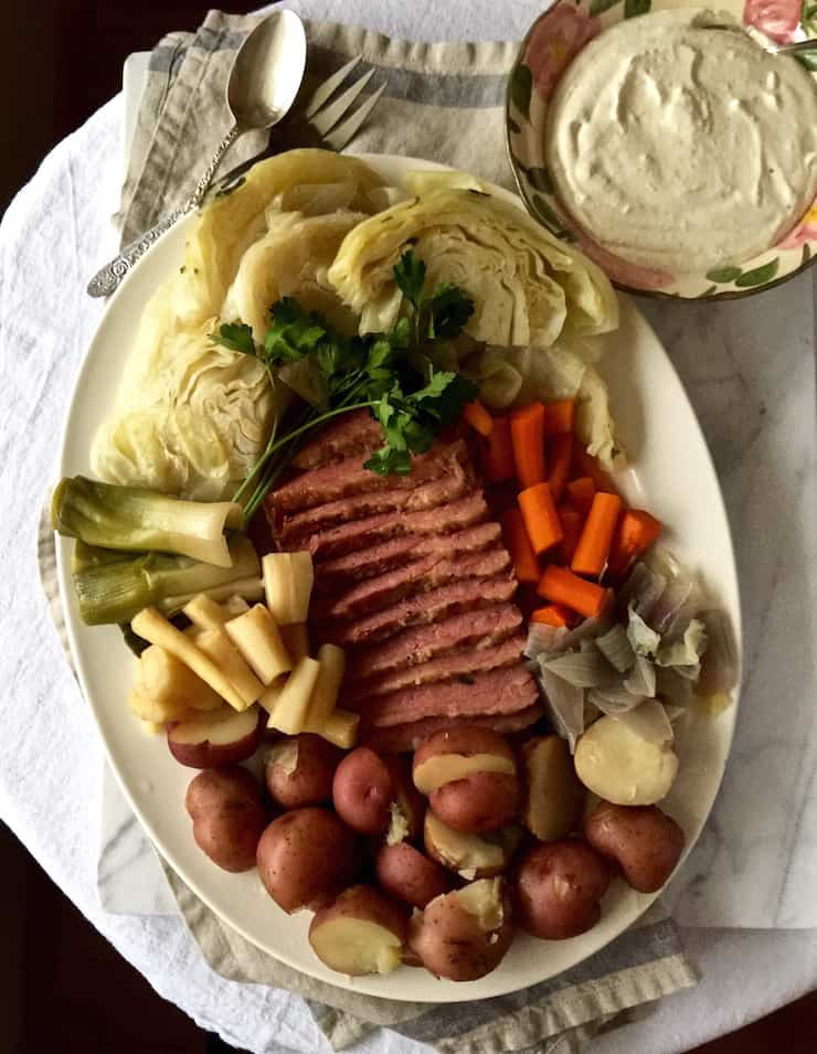 Corned Beef and Cabbage, on serving platter with bowl of horseradish cream sauce.