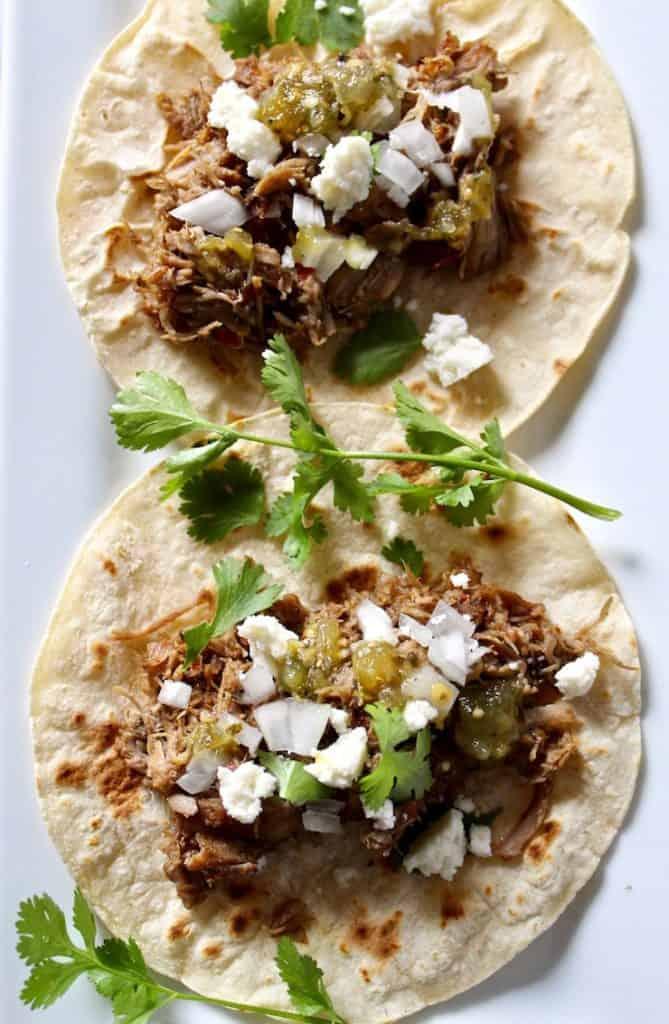 Overhead photo of two carnitas tacos.