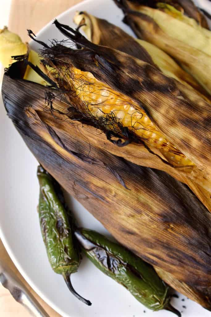 Grilled Corn Salad ingredient photo of grilled corn in the husk and jalapenos