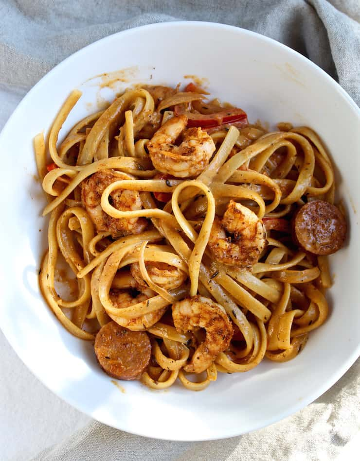 Creamy Cajun Shrimp Pasta with Sausage in white bowl