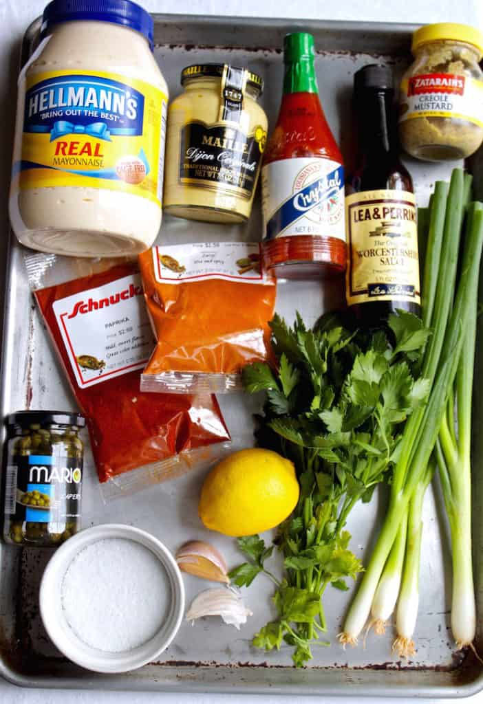 Ingredients for remoulade sauce on display in sheet pan.