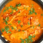 Coconut curry salmon in skillet.