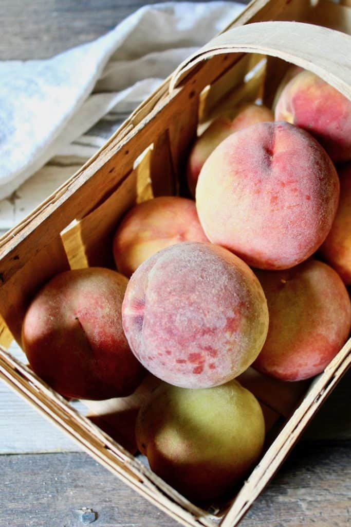 Fresh picked peaches in basket