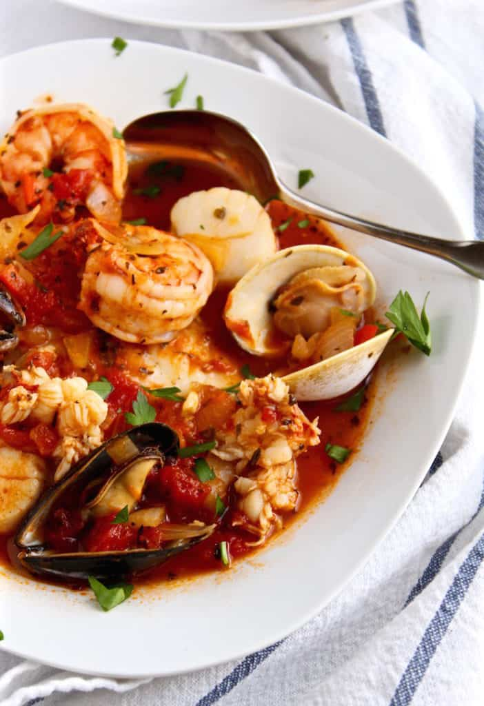 Classic Cioppino, close up in bowl with spoon