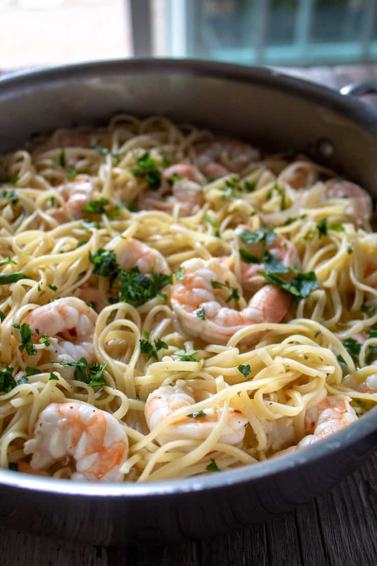 Shrimp Scampi with linguine, side close up in skillet.