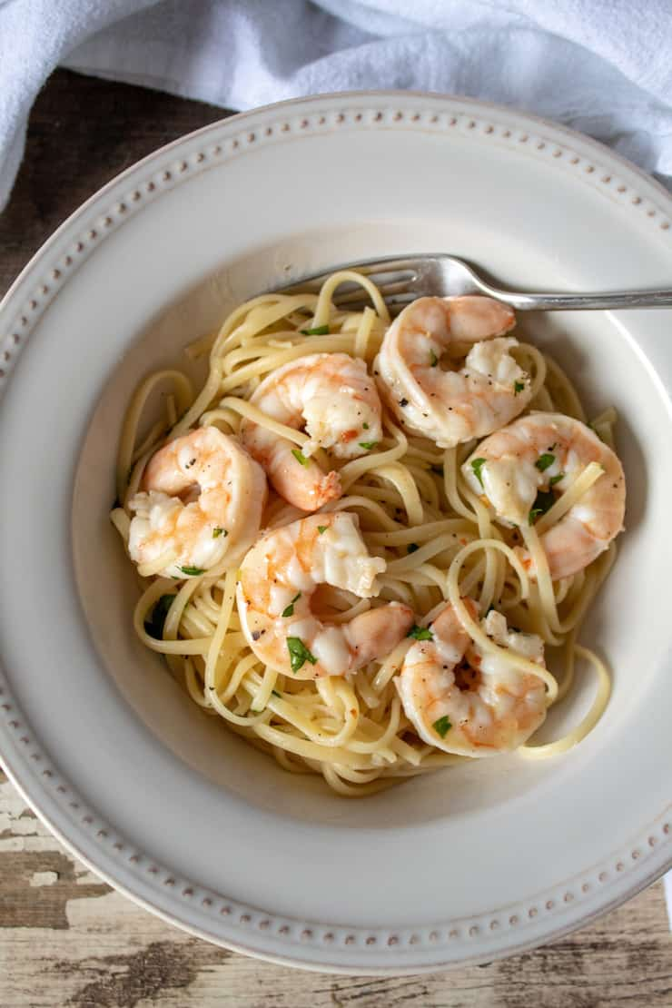 Shrimp Scampi with linguine in serving bowl with fork.