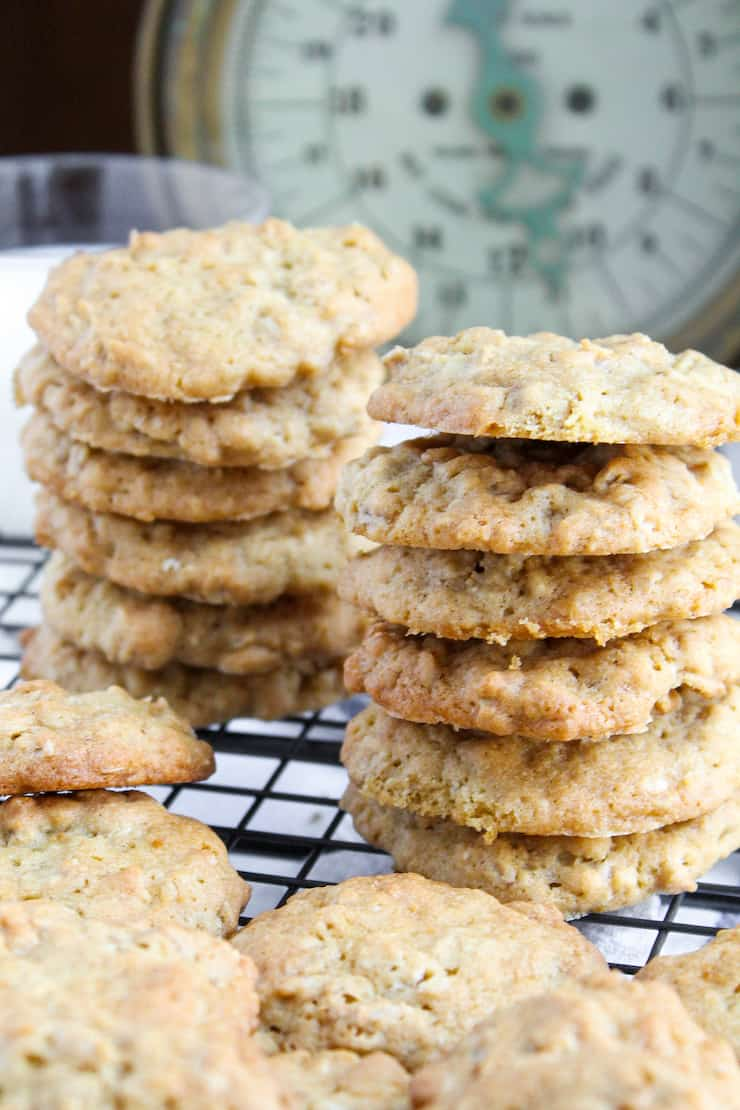 Cookies stacked on wire rack.