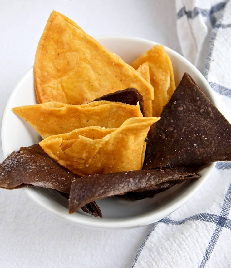 Homemade yellow and blue corn tortilla chips.
