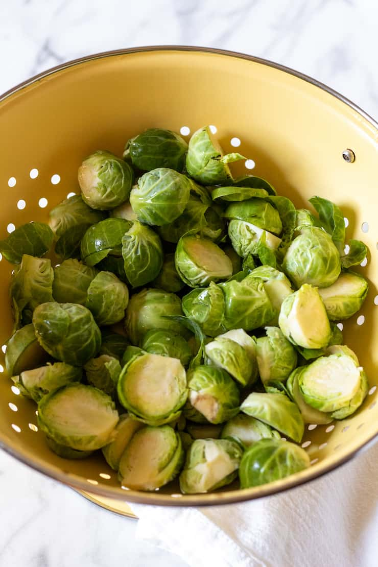 Brussels sprouts cleaned in colander.