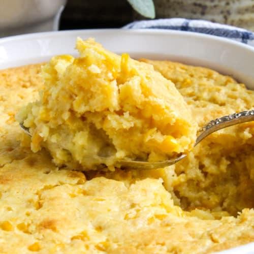 Close up of spoonful of corncasserole.