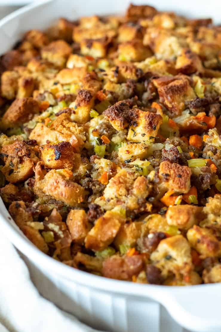 Closeup of old fashioned bread stuffing with browned, crispy top.