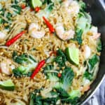 Pad see ew with shrimp in pan.