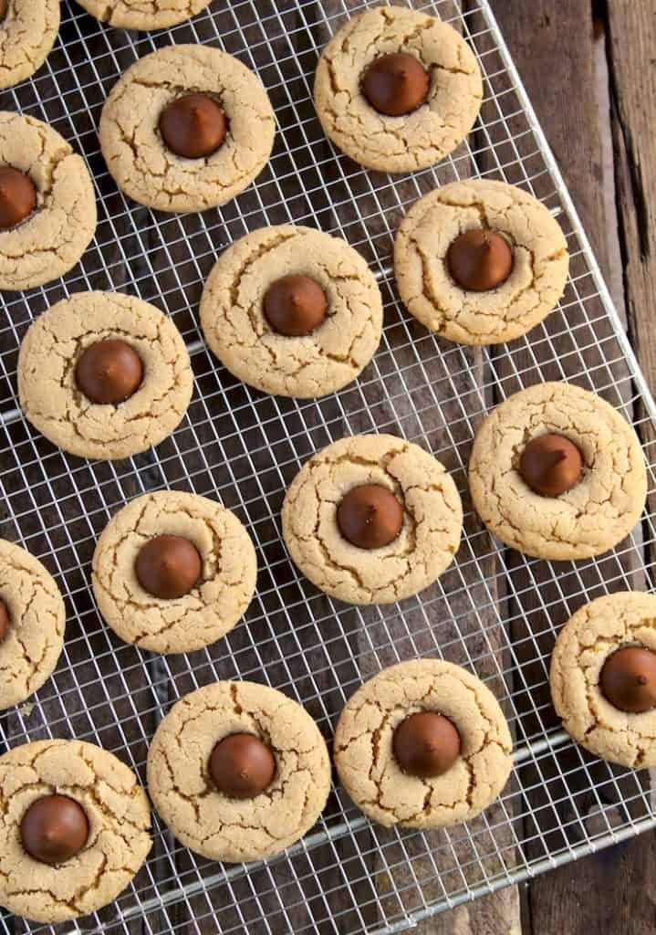 Chocolate Kiss Peanut Butter Cookies, overhead photo of baked cookies on cooling rack.