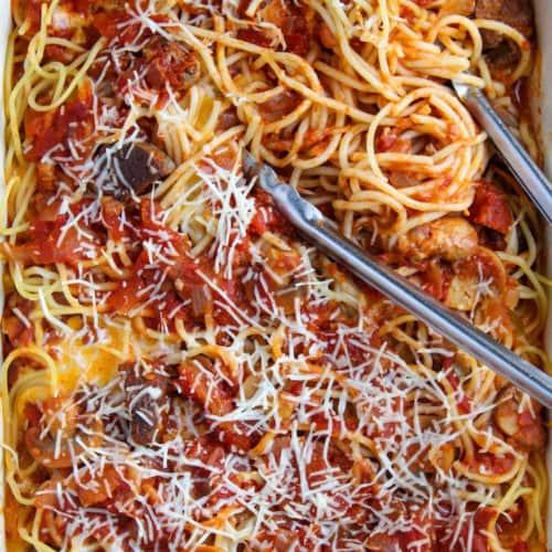 Baked spaghetti in casserole dish.