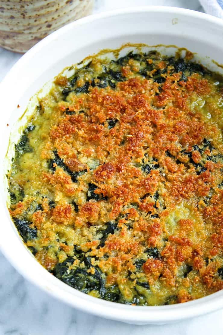 Spinach Rockefeller baked in casserole dish.