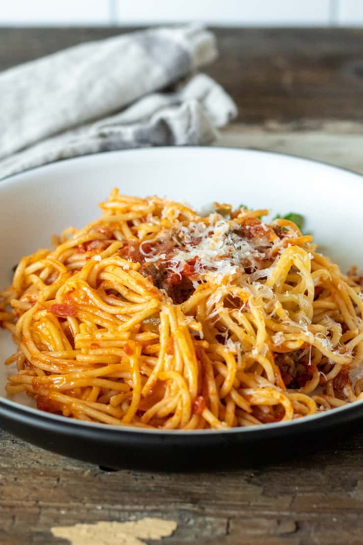 Plate of Italian baked spaghetti.