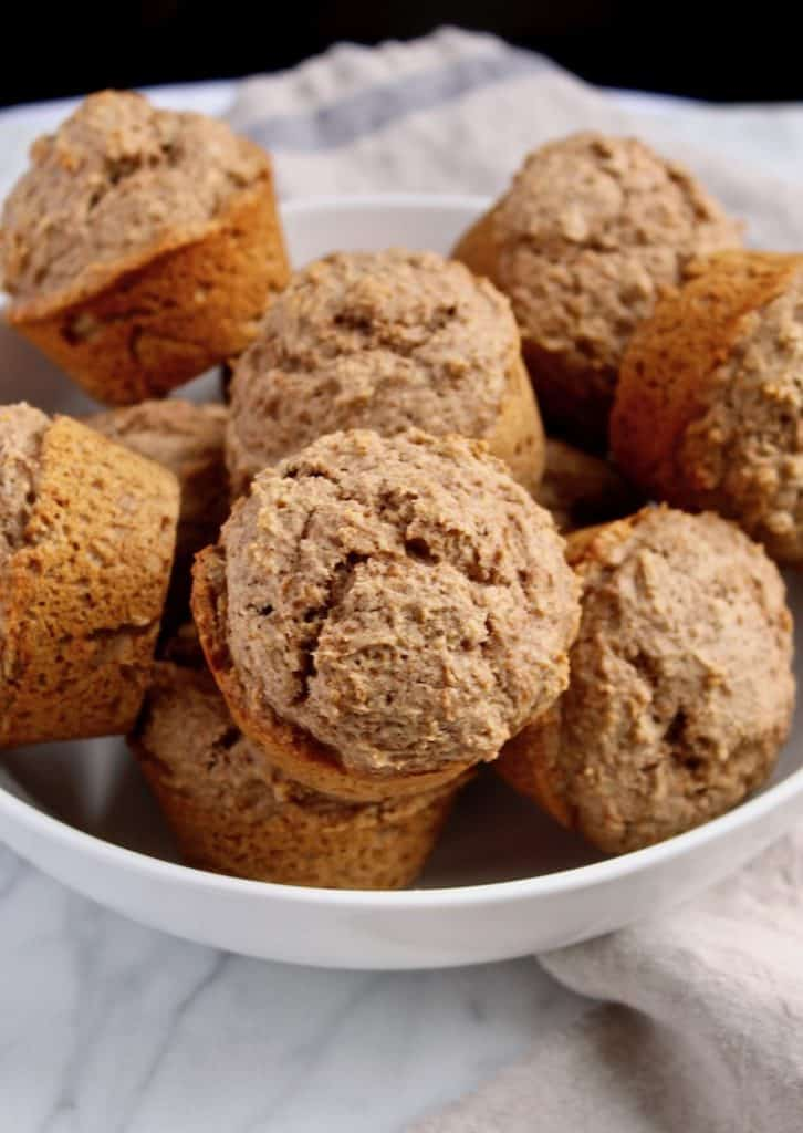 Muffins piled in white bowl.