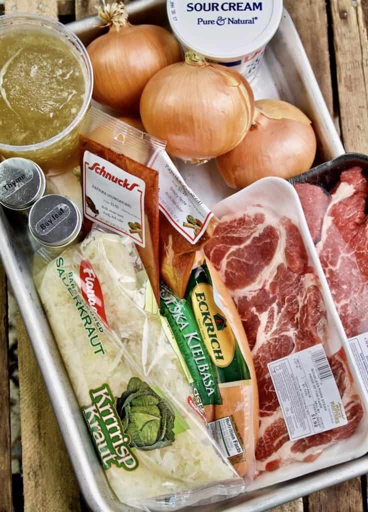 Ingredients displayed in large pan.