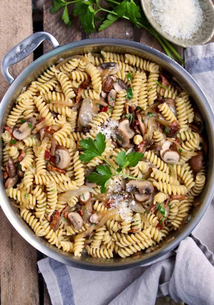 Pasta with Bacon, Onions and Mushrooms, in skillet with grated cheese and parsley