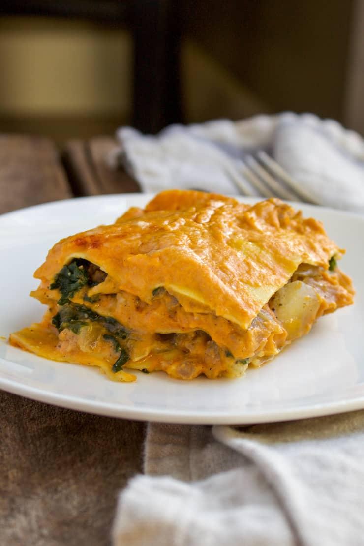 Piece of pumpkin lasagna on white plate.