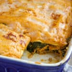 Pan of pumkin lasagna with piece cut out, showing layers.